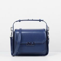 CHARLES & KEITH Top Handle Box Bag (335 SAR) ❤ liked on Polyvore featuring bags, handbags, shoulder bags, navy, structured purse, blue handbags, top handle bag, blue purse and navy purse