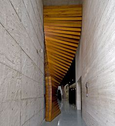 WOW. Now this is an entryway! Designed by the architectural firm Matharoo Associates, the Curtain Door is most definitely a door like no other I've seen. The massive door is made of 40 sections of thick Burma teak and sits between the entrance's concrete walls. Each section has been carved to incorporate 160 pulleys, 80 ball bearings, one wire rope, and a hidden counterweight.