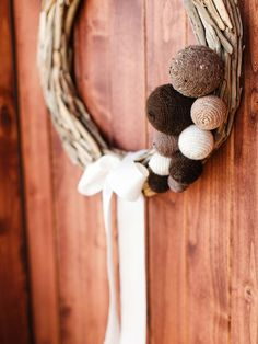 Embellished Wreath  - 8 Easy Front Porch Holiday Decorating Ideas  on HGTV