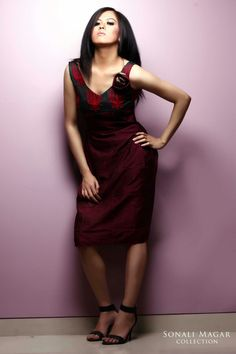 Indo-western one piece made in silk fabric and woollen embroidery.