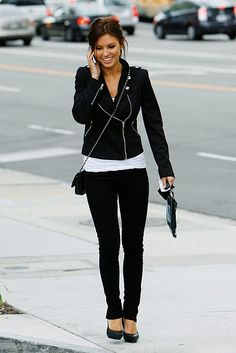 Black pants and jacket with a long white top - Audrina Patridge