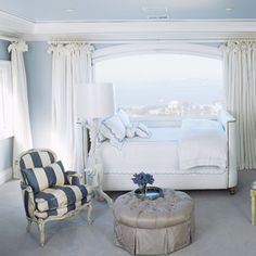 A girl's bedroom is painted in Benjamin Moore's Misty Memories, bringing the blue skies right inside.   - HouseBeautiful.com