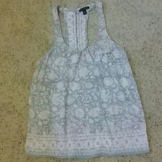 Flowered dressy tank Tank top tee with high back decorated with tiny buttons. Looks great with shorts or jeans. Green, maroon and white. In excellent condition. American Eagle Outfitters Tops Tank Tops