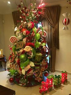 Junky and over the top is necessary for the holidays. Elf Christmas Decorations, Elf Christmas Tree, Christmas Tree Design, Beautiful Christmas Trees, Christmas Centerpieces, Holiday Tree, Christmas Home, Christmas Holidays, Christmas Wreaths