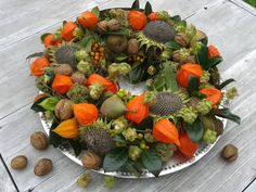 End of summer wreath - sunflower heads, chinese lanterns, walnuts, astrantia