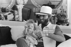 Maurice Gibb with his 1-year-old daughter Samantha in November 1981.
