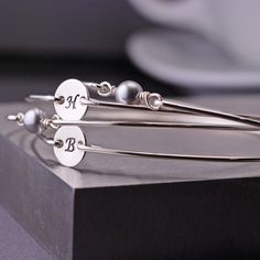 Bridesmaid Gift, 2 sets, Personalized Initial Charm Jewelry, Grey Pearl Bangle Bracelet Set. $108.00, via Etsy.