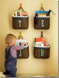 clutter baskets on the wall-a catch all basket that hangs-might do this rather than on the stairs