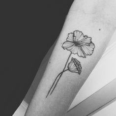 small poppy tattoo by Eszter Feher (tattoos.by.sztrk)
