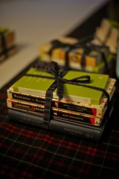 Book Wedding Favors. I would do this, but I don't know what everyone likes to read. Hm.