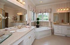 The Rosedale.  Ensutie or master bathroom.  Corner tub, soaker tub, corner windows, white, bright, double sinks, makeup desk, tile, ceramic, antique.... www.qualityhomes.ca