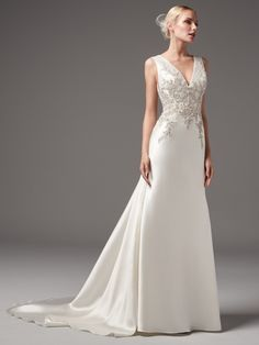 Sottero and Midgley - CLAYTON, This chic and sexy Yaron Mikado sheath features exquisite bead and Swarovski crystal embellishments along the bodice. Featuring a V-neckline and square back with beaded lace illusion detail atop a glamorous tunnel train. Finished with pearl buttons and zipper closure.