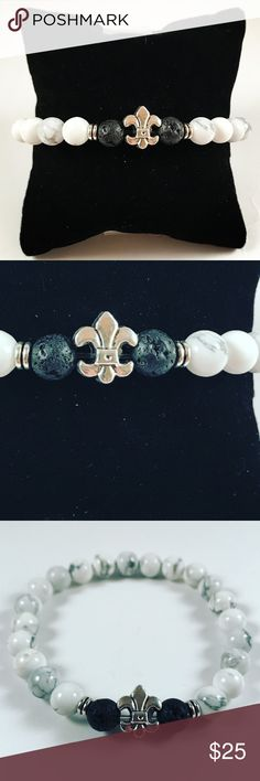 Men black and white fleur de lis beaded bracelet Men beaded bracelet. Fits most , 7.5 to 8.5 inch wrist. Handmade by me , never worn by anyone. Made with black lava rock / volcano rock and white howlite beads . Silver plated fleur de lis charm .I ship fast!!✈️ Bundle and save! ( 10 % off bundles) . Any questions let me know! No transactions outside Poshmark!! Accessories Jewelry