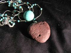 River Side Blues Necklace - turquoise, onyx, magnetite -22.5 inches long. $19.99, via Etsy.