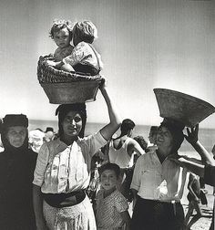 Mother with her children in the basket, 20th century Portugal
