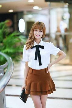 Tie Up this elegant top and look the best of you! This is a super smart peter pan collar top which is sure to make you look the best! Details: - Full sleeves - Solid pattern - Turn down collar - Regul