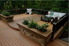 deck with planters and raised lip http://www.ultraoutdoors.com/photos/decks/page/3