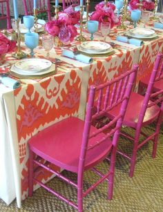 The pink and orange runners are great. Lots of impact with less fabric than a full table cloth. Love the pops of turquoise with the orange and pink!