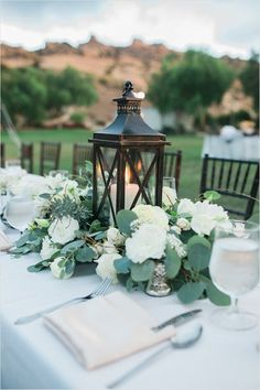 Home » Wedding Ideas » COLOR OF THE YEAR 2017 – Greenery Wedding Centerpiece Ideas » lantern and greenery centerpiece with Flowers only