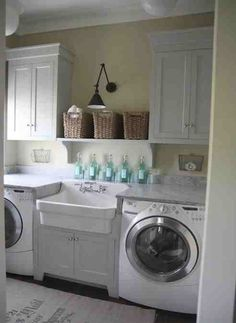 Utility room - not stacked washer / dryer - sink in middle, cabinets on top