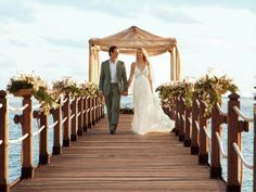 Bride  Groom holding hands on the jetty at the Shanti Maurice A Nira Resort