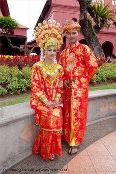 A Malay bride and groom in their traditional Malacca Malay costume MALACCA, MALAYSIA
