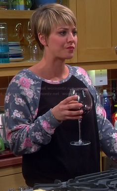 Penny's black sweatshirt with floral sleeves on The Big Bang Theory.  Outfit Details: http://wornontv.net/37687/ #TheBigBangTheory