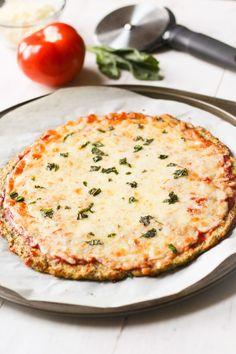 Super-simple cauliflower pizza crust recipe. Gluten and grain free! via thebalancedberry.com
