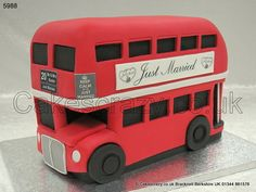 Routemaster Bus Cake. Tickets Please.........   A classic London icon, this novelty shaped London Routemaster double decker bus cake decorated in the popular London Transport red. Complete with personal side board advertising, number and destination board.       Get that bus out Butler....