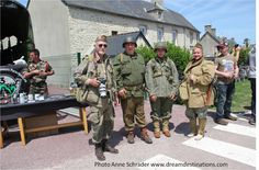4 re-in-actors who posed for a picture in St. Mere Eglise, Normandy France,  June 6, 2014