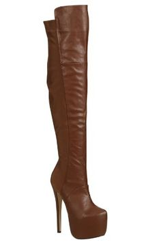 Pair this over the knee, sky high boot with your outfit for some extra sass. Featuring a lengthy stiletto heel on a chunky hidden platform and a back elastic panel to ensure the perfect fit.Made of faux leather material. Imported.