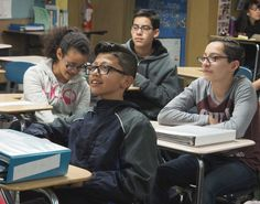 Joahan Nieto, front, and classmates, left clockwise, Daniela Pelayo, Oscar Angulo and Ernesto Contreras, all 7th graders, are taking a college course on early childhood education at Ochoa Middle School in Hayward.