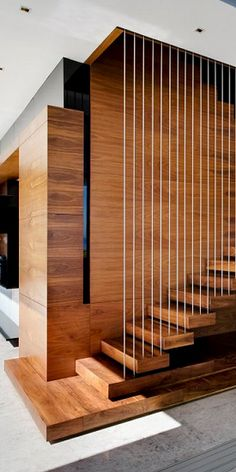 Suspended wooden staircase steps.