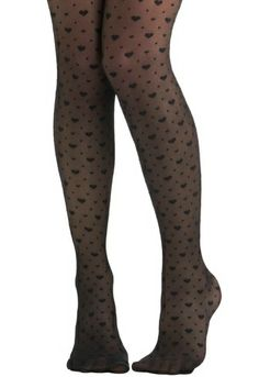 Heart-print and polka dot tights - In this cold weather, these allow you to stay adorable and keep you warm too. More Valentine's Day outfit ideas here: http://www.rewards4mom.com/look-totally-adorable-valentines-30/