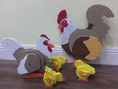 poultry family from wood; rooster, hen, chicks.  My husband did the woodcarving, I painted it. photo by me :-)