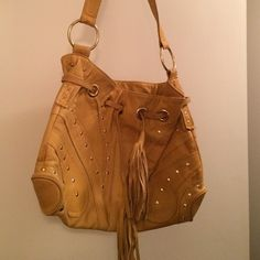 Mustard Bulga bag Beautiful, soft, mustard yellow leather Bulga bag with gold studs. Adorable patterned interior with zip pocket. Gently used but still in great shape! Bulga Bags Hobos