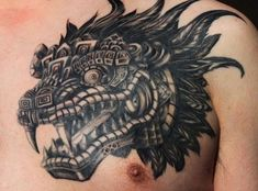 Head of feathered serpent quetzalcoatl aztec tattoo on chest for men