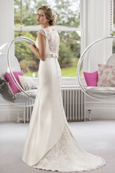 Wedding Dresses & Bridesmaids | True Bride | W130 | Slim fitting Mikado Satin bridal gown with boat neckline, pearl and diamante beaded belt and stunning Guipure Lace back panel and cute detachable bow.