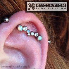 Healed #industrialpiercing with #titanium and #opal jewelry by #anatometal (at Evolution Body Piercing)