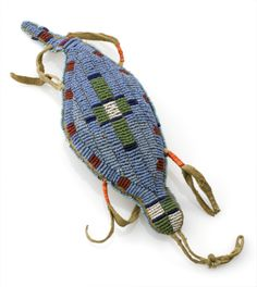 Made from leather and decorated with beads and porcupine quills, this turtle-shaped amulet is thought to contain an umbilical cord. The amulet was worn by girls until they reached puberty to ward off illness. In many Native American belief systems, turtles were thought to look after women's diseases. It was possibly made by the Sioux people of the Great Plains, in North America.