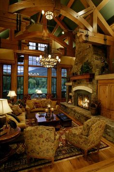 There is so much to look at in this room...the rafters, the light fixtures, the fireplace....and the gorgeous view out those spectacular windows.
