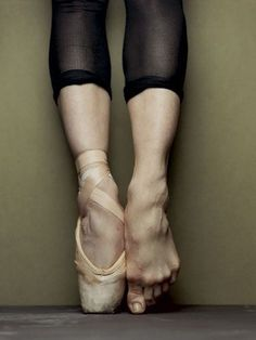 Inside those toe shoes, the feet aren't what most would call beautiful.  But power and strength is always beautiful, in my eye.