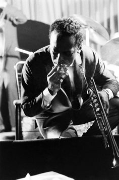 """expressionsrealia:    viaLIFE: """"Unpublished Photos of a Jazz Giant""""        Miles Davis takes a break from performing at a club in New York, 1958. From aTIME Magazineprofile of Davis, written in January 1958: """"On the bandstand, trumpeter Miles Davis resembles a man who wandered in off the street for a nightcap and decided to stick around for a few licks on a borrowed horn. He will noodle his way through a solo, turn to chat with another player, stroll to a nearby table for a drag on a…"""