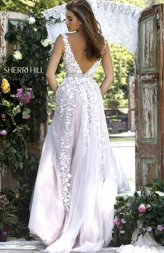 Imbue the evening with romance in the breathtaking Sherri Hill 11335 full-length prom dress. https://www.pinterest.com/behzadj/jovani-prom-dresses/ and https://www.pinterest.com/behzadj/blush-prom-dresses/ for other awesome prom dresses. The Sherri Hill line is selling out fast.
