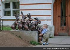 Cute kid trying to help a statue