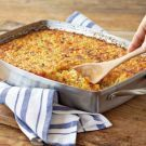 Try the Corn Pudding Recipe /1/2 cup fresh bread crumbs 1 1/2 cups grated cheddar cheese 4 lb. corn kernels, about 14 cups 6 shallots, peeled 2 cups heavy cream 1/4 tsp. Tabasco sauce 1 Tbs. salt 1/2 tsp. freshly ground pepper 12 eggs 1 Tbs. chopped fresh thyme