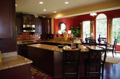 Love the cabinets and counters and set up but need lighter colors on the walls with such dark cabinets