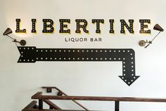 Visual identity and hand painted signage designed by CODO for Indianapolis liquor bar Libertine
