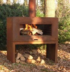 Corten Steel Outdoor Standing Fireplace With Wood Store by Adezz -