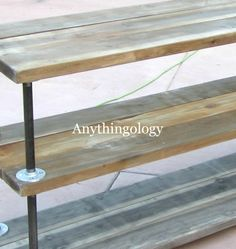 Anythingology: DIY Industrial Shelves and distressing new wood. This size would be great behind a couch, in a dining room, etc. I love the distressed look.